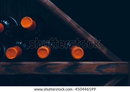 Close-up of several bottles of wine in row. Useful as a background #450446599