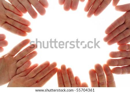 Close-up of several human palms making circle