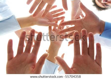 Close-up of several human palms over camera