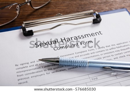 Close-up Of Sexual Harassment Complaint Form With Pen At Desk #576685030