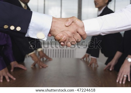 Close up of shaking hands.