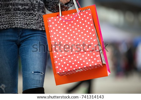 Close up of shopping bags carrying by woman at the city street #741314143