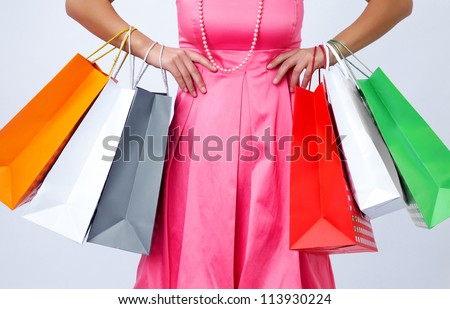 close-up of shopping bags in their hands stylish women. unrecognizable