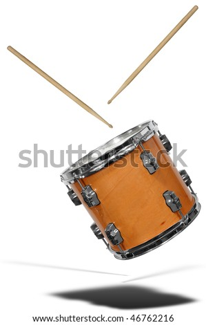 close up of side view of a snare drum floating with drum sticks isolated over white - stock photo