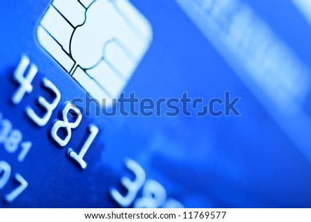 Close-up of silver digits and chip on a credit card  shallow depth of focus. Cooling filter