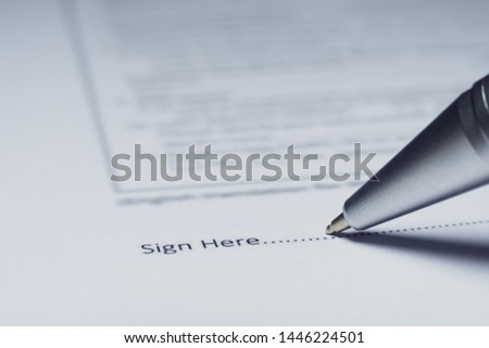 Close-up of silver pen are signing contract agreement. Contract agreement policy concept. #1446224501