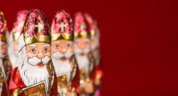Close-up of Sinterklaas. Saint  Nicholas chocolate figurine of  Dutch character of Santa Claus. With copy space.