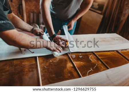 Close Up of Skilled Artisan Carpenter Working on a Piece of Furniture in his Workshop