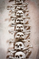 Close-up of skulls and bones decorating the interior of the Sedlec ossuary (Kutna Hora, Czech Republic)