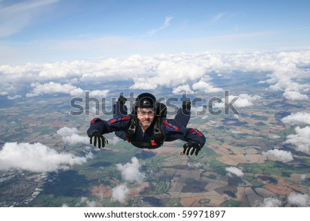 Close up of skydiver in freefall on a sunny day