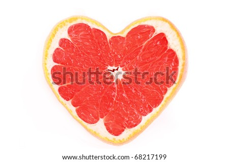 Close up of sliced pink grapefruit in the form of heart isolated on white