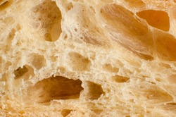 Close up of sliced wheaten bread; bread texture as a background