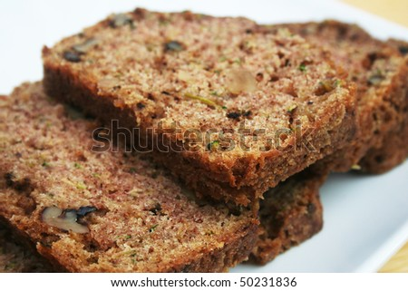 Close up of slices of zucchini bread on a white plate