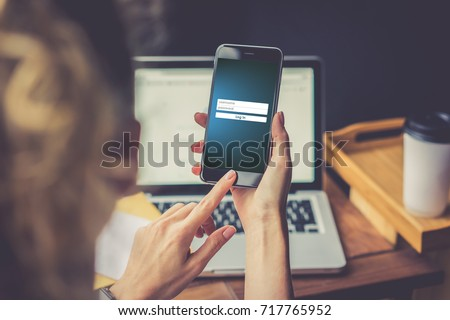 Close-up of smartphone with inscriptions on screen - user name, password, log in. Foreground and background in soft focus. Online marketing, education, e-learning, e-commercial, social media, network. #717765952