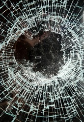 Close up of smashed glass in a shop window.