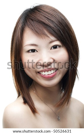 Close up of smiling Asian woman on white background