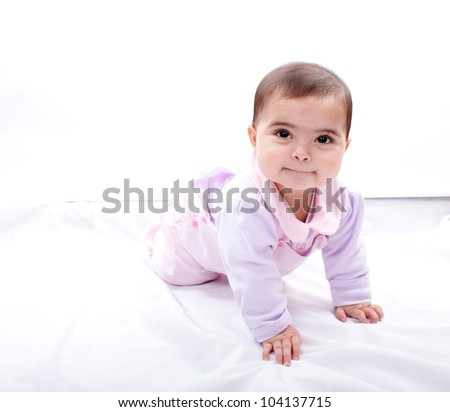 Close up of smiling baby crawling on floor