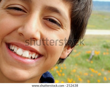 Close up of smiling boy against poppy field