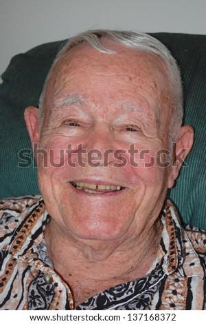 Close-up of smiling elderly man.