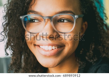 close up of smiling female face ...