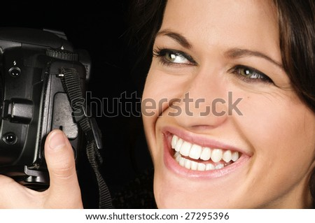 Close-up of Smiling Female Photographer w/SLR