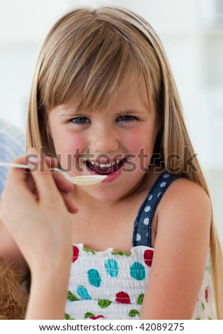 Close-up of smiling girl taking medecine in the hospital
