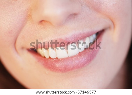 Close-up of smiling girl with beautiful teeth