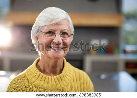 Close-up of smiling senior woman looking at camera #698385985