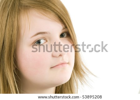 Close-up of smiling Teenager girl  looking on the white background - stock photo