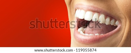 Close Up Of Smiling Teeth against a red background