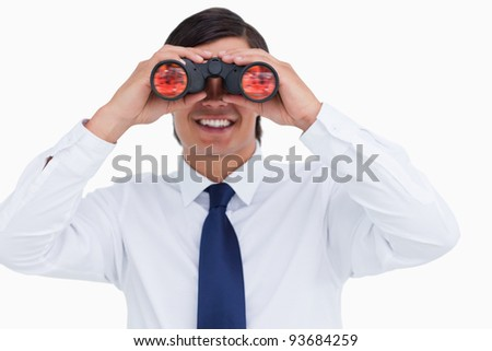 Close up of smiling tradesman looking through spy glass against a white background - stock photo