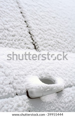 Close-up of snow-covered car doors