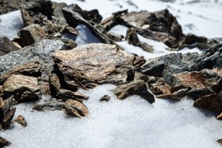 close up of snow mountain shining stones, macro photography of nature and minerals in Caucasus Mountains