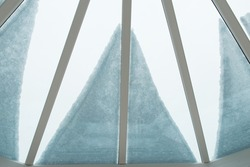 close up of snow on conservatory roof, from inside looking out, creating a petal and linear shaped pattern