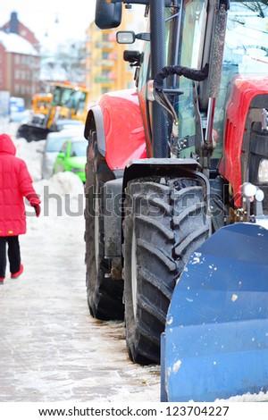 Close up of snow plow on sidewalk / street. Intentional crop.