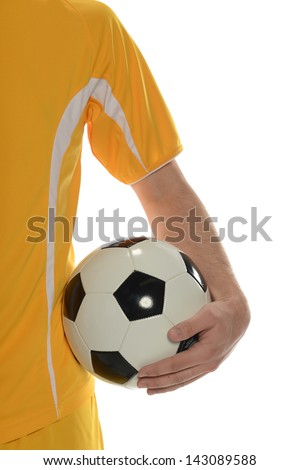 Close up of soccer player holding the ball isolated on a white background