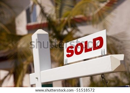 Close-up of Sold Real Estate Sign in Front of House.