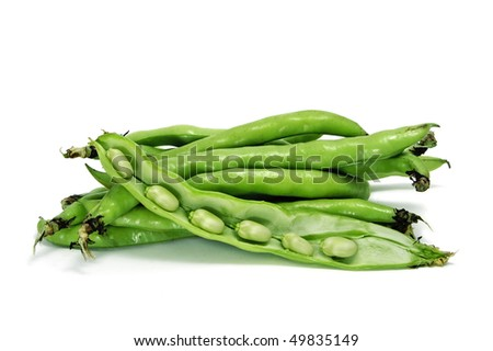 close up of some broad bean pods with the beans inside