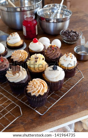Stock Photo Close up of some decadent gourmet cupcakes frosted with a variety of frosting flavors.