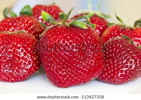 close-up of some fresh red strawberries