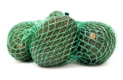 Close-up of some organic hass avocado fruits in a green mesh bag isolated on a neutral background.