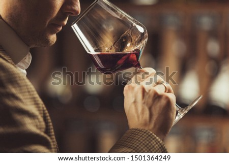 Close up of sommelier man sniffing wine in glass Stock photo ©