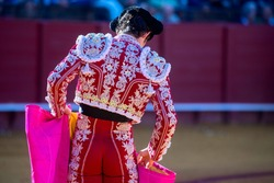 CLOSE UP OF SPANISH BULLFIGHTER TYPICAL CUSTOME