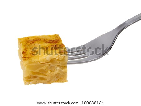 Close-up of Spanish omelette snack  on a fork, isolated on a white background.Spanish tapas. Tortilla espa���±ola.