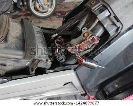 Close-up of spare part component motor vehicle under maintenance. Electronic component motor vehicle #1424899877