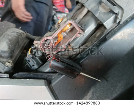 Close-up of spare part component motor vehicle under maintenance. Electronic component motor vehicle #1424899880