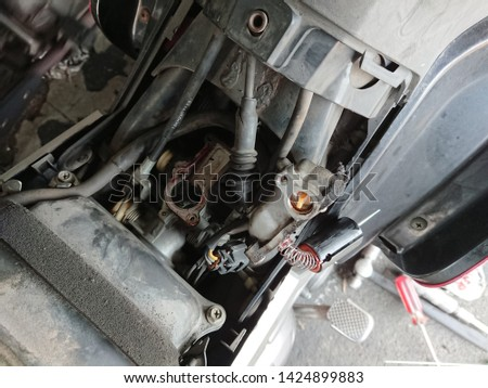 Close-up of spare part component motor vehicle under maintenance. Electronic component motor vehicle #1424899883