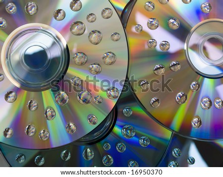 Close up of  sparkling optic media discs with drops