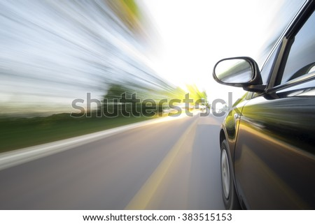 Close-up of speedy on car road.