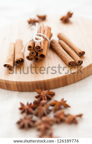 Close up of spices cinnamon and anise for christmas cake. Dried aromatic spices on a wooden kitchen board